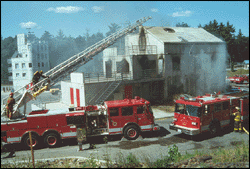 firetrucks in front of a burning building